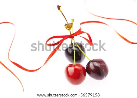 cherry with ribbon isolated on white
