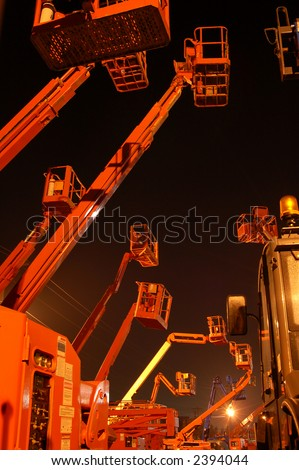 Cherrypickers by night - stock photo