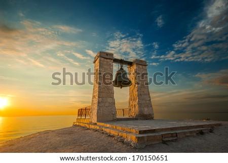 Chersonese bell at sunset near the sea - stock photo