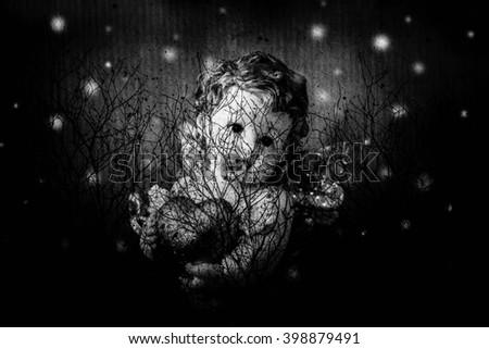 Cherub angel statue with heart,Double exposure cherub angel with dry tree,Love concept - stock photo