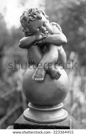 cherub at the cemetery - stock photo