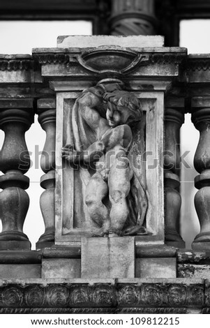 Cherub detail in stonework - stock photo