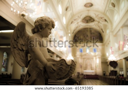 Cherub Statue in St. Louis Cathedral - stock photo