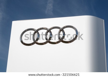 Cheshire,UK - September 28th 2015: Audi logo on a sign outside the car or automotive dealership. All car brands are under scrutiny after the VW emissions scandal. - stock photo