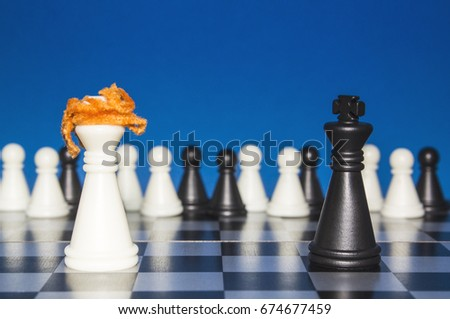Chess as a policy. A lone white figure with red hair against a lonely black figure. The public looks from the outside.
