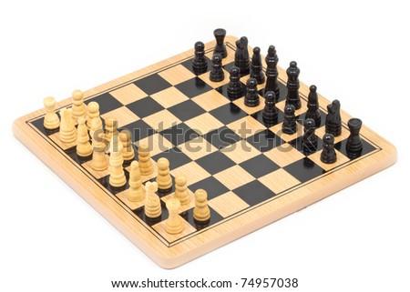 Chess battle on wood board - stock photo