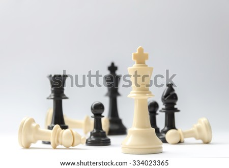 chess battle - plastic chess pieces, selective focus - stock photo