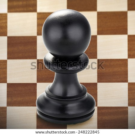 Chess - black pawn on a chessboard - stock photo