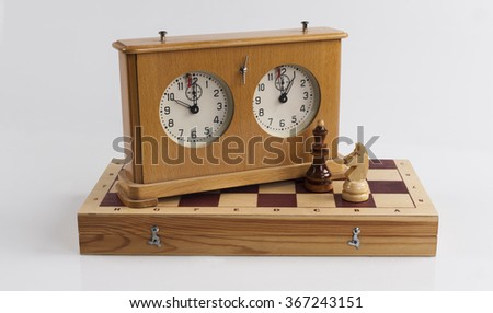 chess board and chess clock on a white background - stock photo
