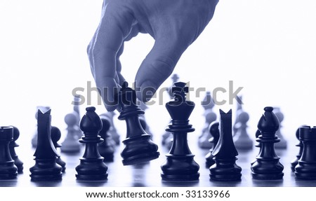 Chess board and hand blue tone - stock photo