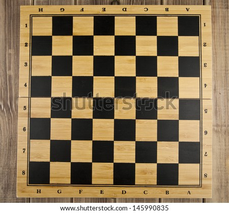 chess Board on a wooden table - stock photo