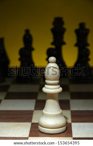 Chess board with chess pieces on dark color background - stock photo