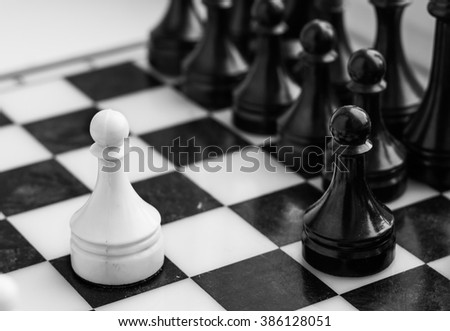 Chess board with figures close-up photo, monochrome. - stock photo