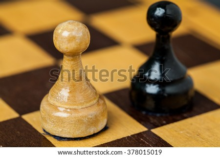 Chess. Chess on the chessboard. Two figures. Two pawns.
