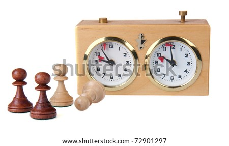 Chess clock and chess pieces isolated on white - stock photo