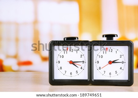 Chess clock on light background - stock photo