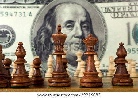 Chess composition on dollar background - stock photo