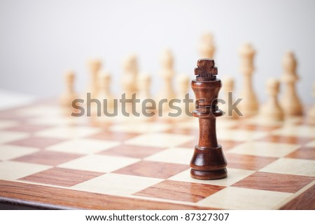 chess concept on the grey background - stock photo