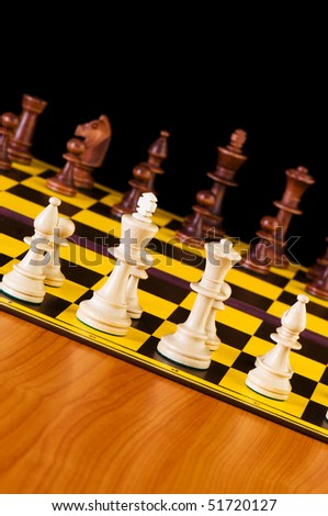 Chess concept with pieces on the board - stock photo