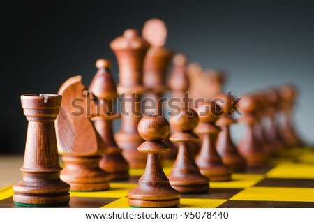 Chess concept with various pieces - stock photo