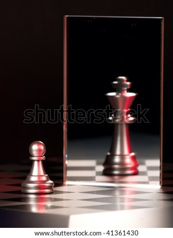 Chess figure and mirror on a black background - stock photo
