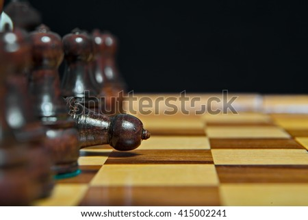 Chess figure. Losing game. - stock photo
