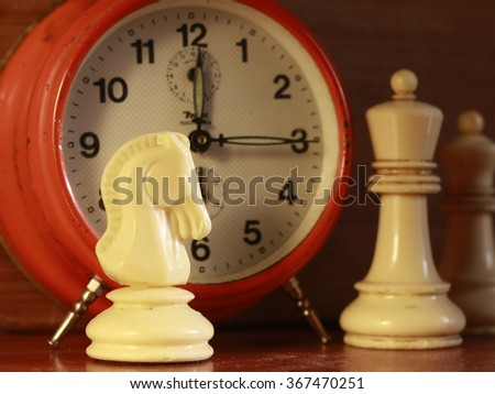 chess figures and clock - stock photo