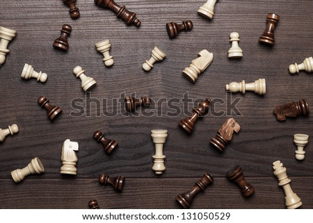 chess figures on the brown woden table