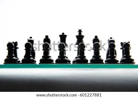 Chess game. Black chess pieces on the board are in two rows. chess on a white background, front view