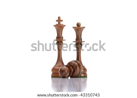 chess game - black pawn lying under  black king and queen - stock photo