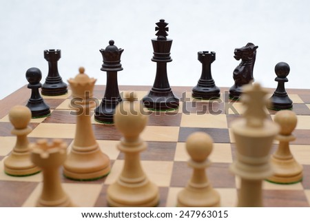 Chess game (focus on King, isolated on white background) - stock photo