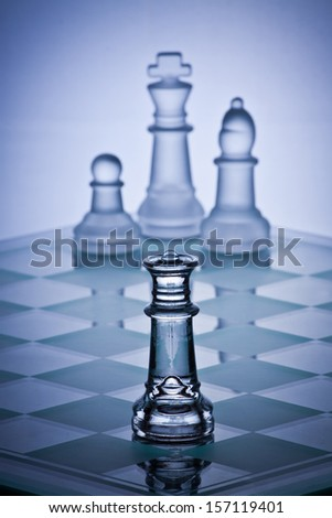 Chess game showing a king cornered by a queen - stock photo