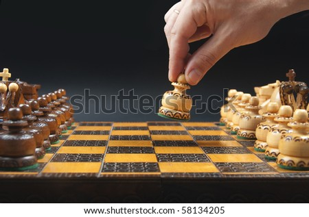 Chess game starts - white moves the pawn - stock photo
