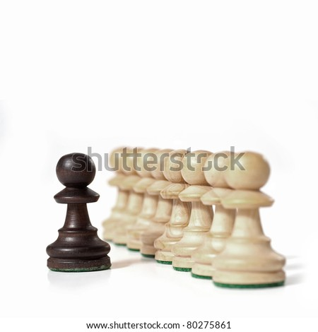 Chess game. White prawns in a row with black one. Leadership concept. - stock photo