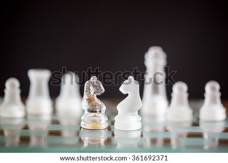 Chess horse glass start up game for your business competition on chess board. - stock photo