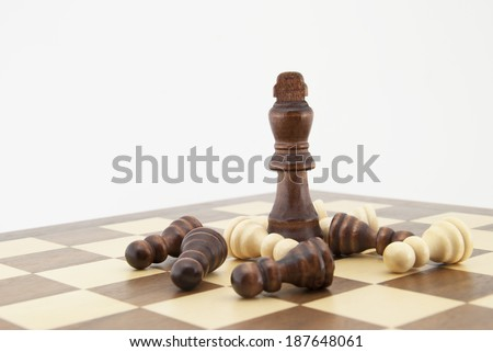 Chess king and pawns on chessboard with white background. Landscape format. - stock photo