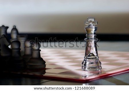 Chess King as a business concept - strategy, advertising, marketing, sales, competition, leadership, CEO, business skills - King in light, other pieces in shadow - advertising!  - stock photo