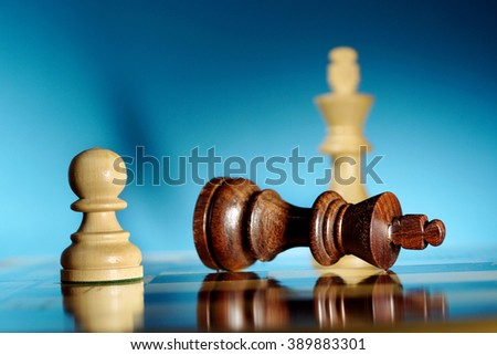 Chess king defeated by pawn - Chess game over - stock photo