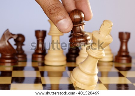 Chess king defeated by pawn piece - stock photo