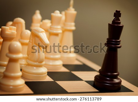Chess king in a symbolic surrendering position