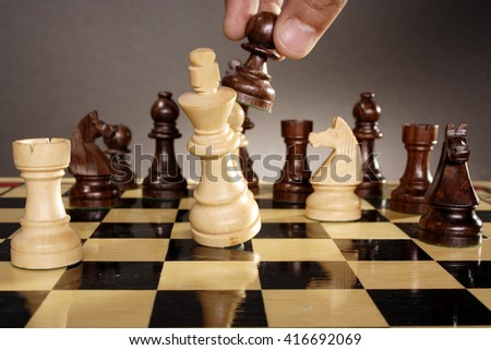 Chess king is checkmated by pawn - stock photo