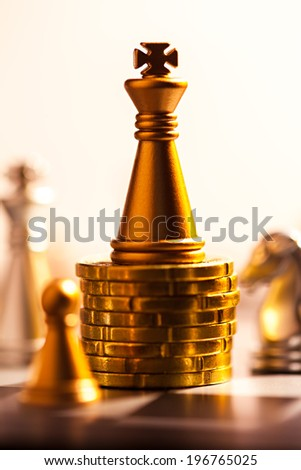 Chess king on a coins. Finance concept. - stock photo