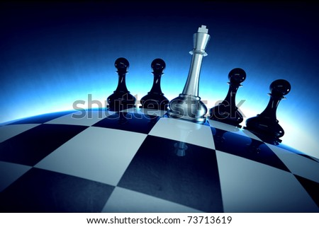Chess king with four pawns on spherical checker surface - stock photo