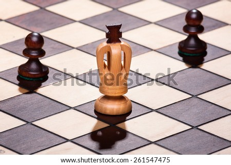 chess king with two pawns - stock photo