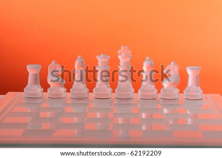 chess on an orange background - stock photo