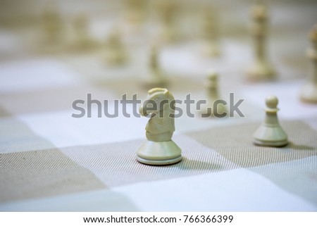 Chess on checkered fabric