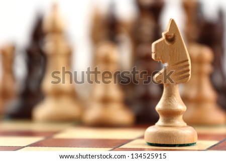 chess on chessboard close up in studio - stock photo