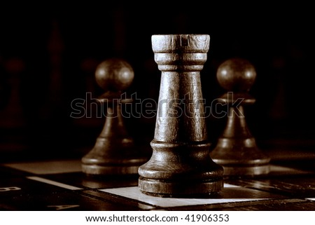 Chess on the dark background. - stock photo