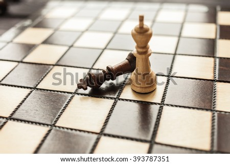chess on the wooden rustic background - stock photo
