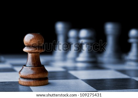 chess pawn isolated on black background - stock photo